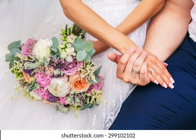 bride and groom with beautiful wedding bouquet