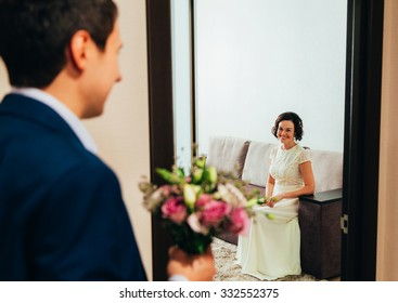 bride and groom with a bouquet