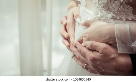 The bride and groom Caressing bride's Pregnant belly