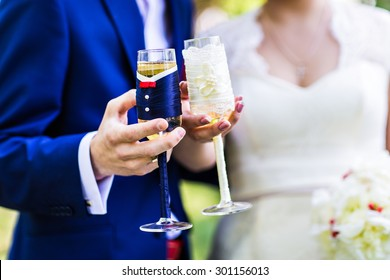 bride and groom with champagne glasses clink