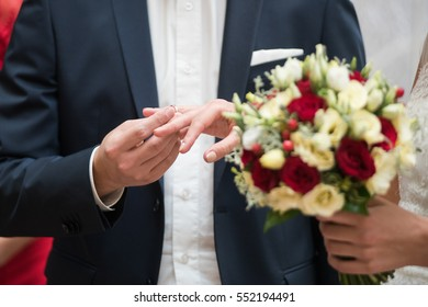 bride and groom are changing rings on wedding ceremony