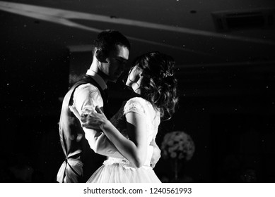 Bride and groom are dancing