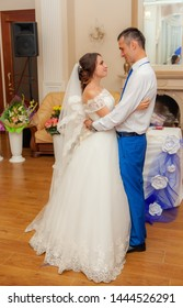 Bride and groom dancing waltz