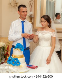 Bride and groom eat wedding cake