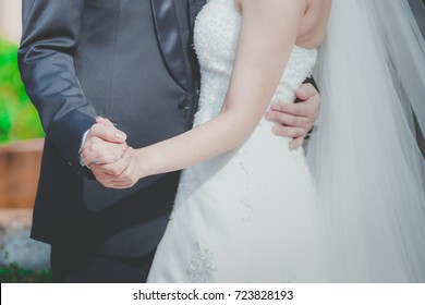 The bride and groom embrace each other with love at the wedding ceremony.