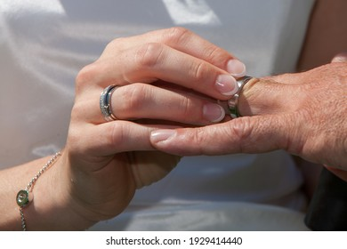 Bride and groom exchanging rings. High quality photo