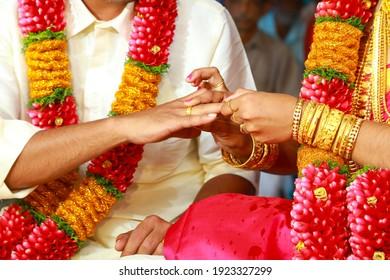 Bride and Groom exchanging rings .Traditional Kerala Hindu Wedding.