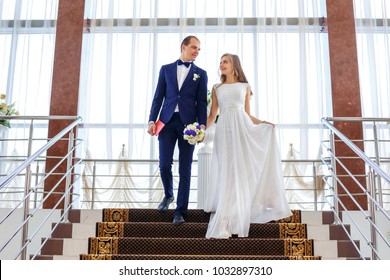 bride and groom, feelings. wedding bride and groom. the bride's bouquet in hands. wedding day. happy people. New married couple. concept of love and happiness