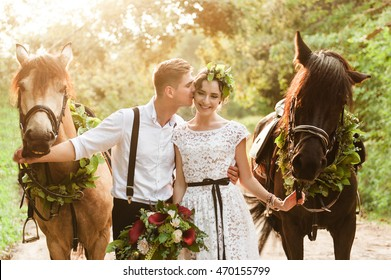 Bride and groom in forest with horses. Wedding couple with horses.Beautiful bride and groom portrait in nature