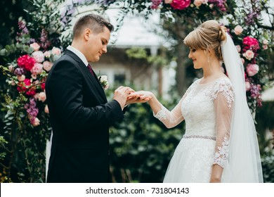 Bride and groom are getting married on the wedding ceremony