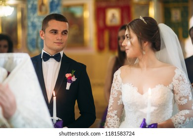 The bride and groom give a vow of love in the church