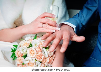 Bride and groom with glasses of champagne and flowers