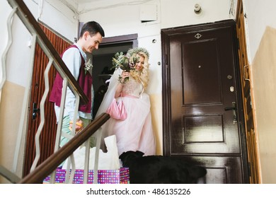 the bride and groom going out from home