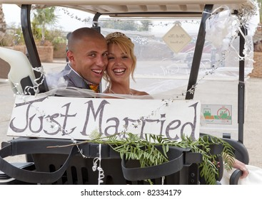 Bride and Groom in a golf cart at the reception at a golf course