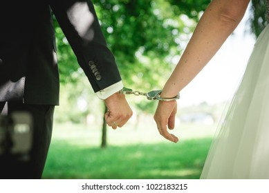 Bride and groom in handcuffs