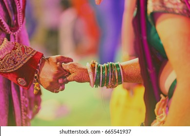 bride and groom hands , indian wedding