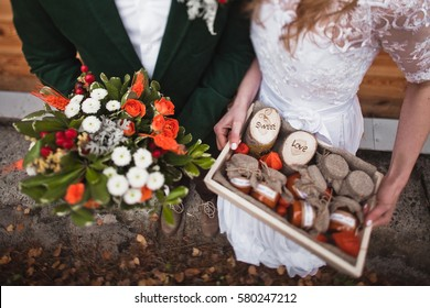 bride and groom hanging wedding bouquet on rustic autumn wedding