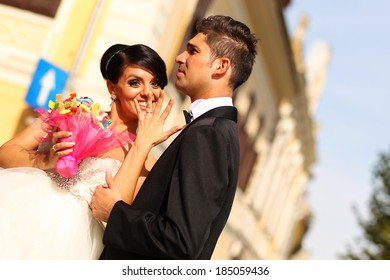 Bride and groom having fun in the city