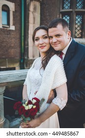 Bride and groom holding beautiful wedding bouquet