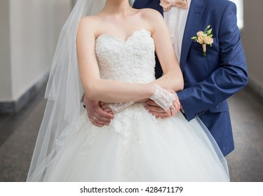 The bride and groom are holding each other