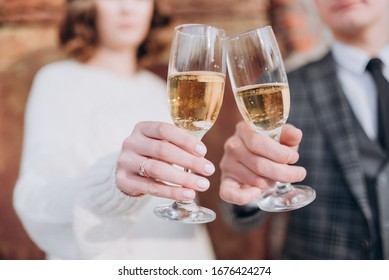 the bride and groom are holding glasses of champagne