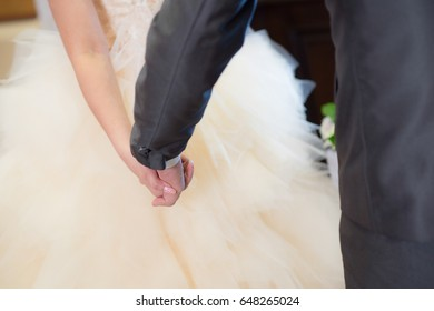 Bride and Groom holding hand together in wedding day
