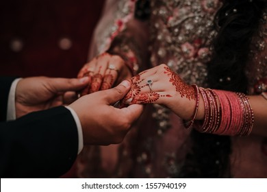 Bride and Groom holding hands at their wedding in Pakistan