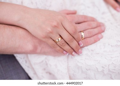 Bride and groom are holding hands together