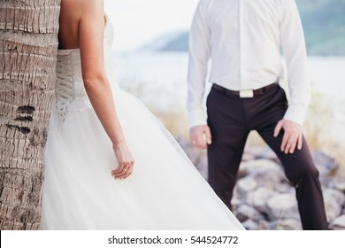 bride and groom holding hands together. Fine art style