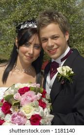 Bride and Groom in loving embrace, UK.
