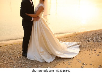 Bride and groom near water