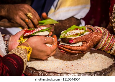 Bride and Groom Offer Rice as a Symbol of Plenty at a South Indian Wedding Ceremony Wedding in Hyderabad, India
