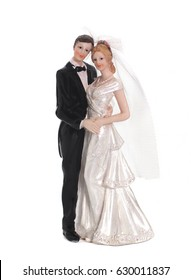 Bride and groom, old cake topper on white background
