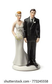 Bride and groom, old plaster cake topper on white background