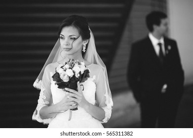 Bride and groom on the background of wooden wall