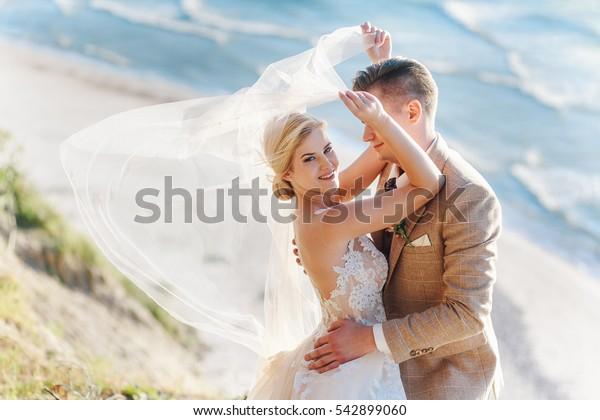 the bride and groom on the beach. Klaipeda, Lithuania