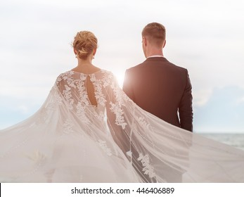 Bride and groom on the beach with a romantic moment