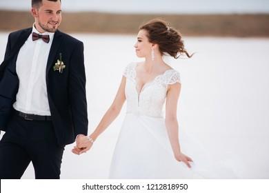 bride and groom on a salt lake