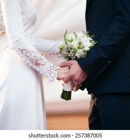 Bride and groom on wedding ceremony. Focused on wedding bouquet