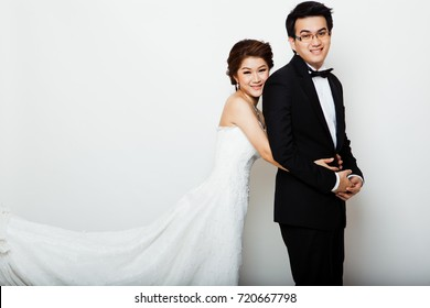 The bride and groom on white background. Asian wedding couple on white background.