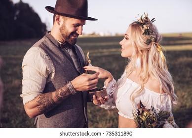 bride and groom outdoors. wedding ceremony. wedding arch