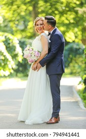 Bride and groom in a park kissing.couple newlyweds bride and groom at a wedding