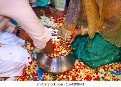 Bride and Groom playing find the ring game in south indian wedding ceremony