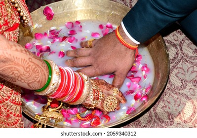 The Bride and Groom playing find the ring game in North Indian Wedding  Marriage Ceremony. Hindu culture traditional ceremony