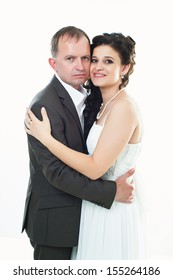 Bride and groom portrait in studio. Wedding on a white background. Elegantnye newly-married couple