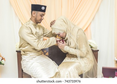 bride and groom pose during malay wedding celebration in Malaysia