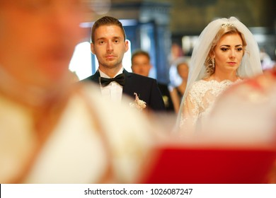 bride and groom posing in church