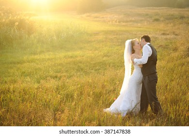 Bride and Groom Posing in the Field