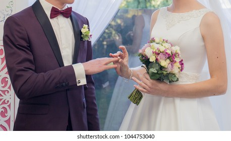 the bride and groom put on rings