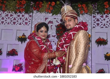 Bride and groom putting garland as a ceremonial proceeding as per Hindu Marriage Rituals. The Garland and is made of roses and white flower buds